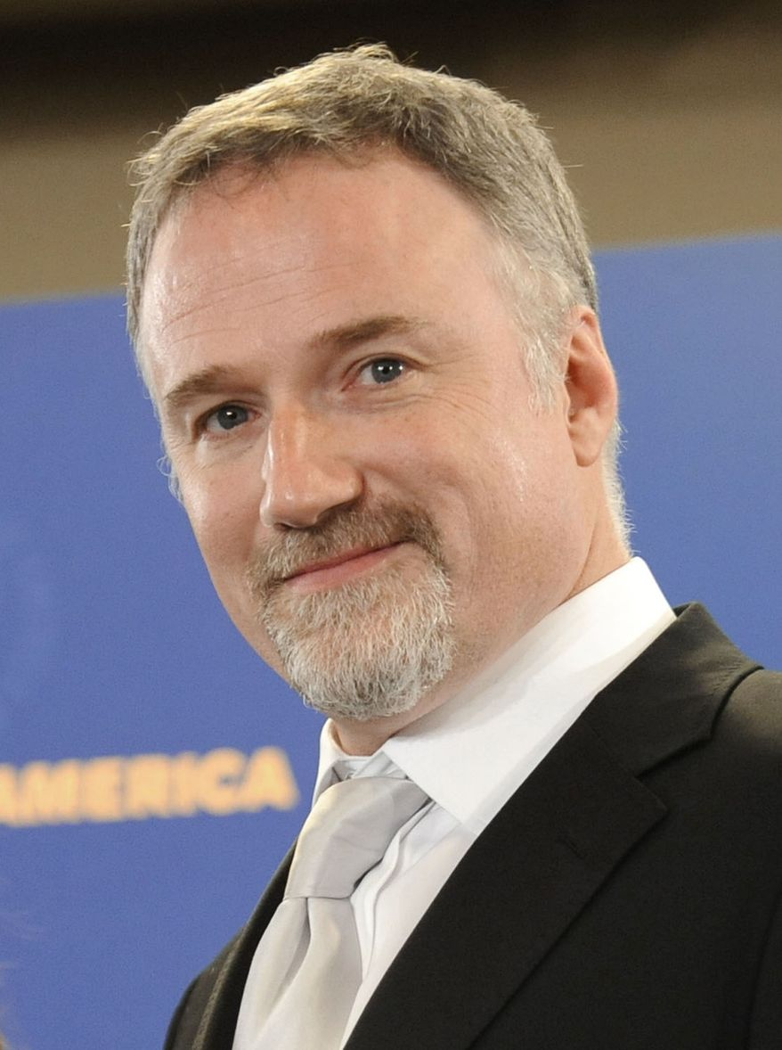"""** FILE ** In this Jan. 31, 2009, file photo, director David Fincher is shown backstage at the Directors Guild of America Awards in Los Angeles. Fincher was nominated for an Academy Award for best director for """"The Social Network,"""" on Tuesday, Jan. 25, 2011. The Oscars will be presented Feb. 27 at the Kodak Theatre in Hollywood. (AP Photo/Chris Pizzello, file)"""
