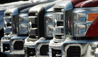 ** FILE ** A lineup of F-250 trucks shows a bit of ice at Formula Ford in Montpelier, Vt. Ford earned its biggest profit in more than a decade in 2010 as robust car and truck sales and years of cost cutting paid off for the company. (Associated Press)