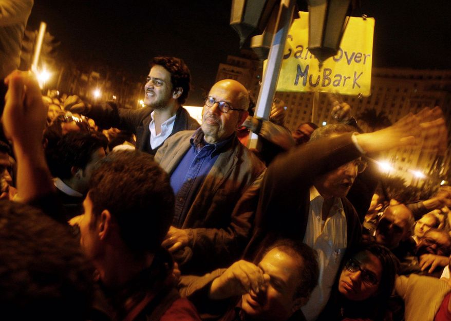 Egyptian Nobel Peace Prize winner and democracy advocate Mohamed ElBaradei prepares to address protesters Sunday in Cairo's Tahrir Square. Mr. ElBaradei, under house arrest since his return to Egypt last week, joined thousands defying a curfew. (Associated Press)