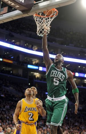 Boston Celtics forward Kevin Garnett (right) shoots as Los Angeles Lakers guard Derek Fisher looks on during the first half of the Celtics' 109-96 victory Sunday in Los Angeles. (Associated Press)