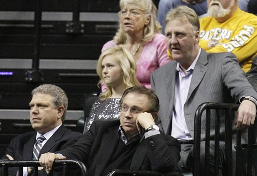 FILE - In this Jan. 28, 2011, file photo, Indiana Pacers general manager David Morway, left, owner Herb Simon, front right, and president of basketball operations Larry Bird, upper right, look on during an NBA basketball game against the New Jersey Nets in Indianapolis. The Pacers have reportedly fired coach Jim O'Brien after failing to make the playoffs in three losing seasons. Several media outlets reported the firing Sunday, Jan. 30. The Pacers called a 4 p.m. news conference with Bird, and a person with knowledge of the situation told The Associated Press on condition of anonymity that Bird will discuss the coaching situation. (AP Photo/Darron Cummings, File)