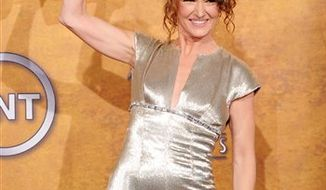 "Melissa Leo holds the award for best female actor in a supoorting role for her work on ""The Fighter"" at the 17th Annual Screen Actors Guild Awards on Sunday, Jan. 30, 2011 in Los Angeles. (AP Photo/Vince Bucci)"