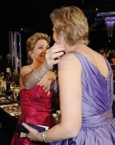 Julianna Margulies, left, and Helena Bonham Carter are seen at the 17th Annual Screen Actors Guild Awards on Sunday, Jan. 30, 2011 in Los Angeles. (AP Photo/Mark J. Terrill)