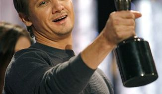 Actor Jeremy Renner, center, and stand-ins laugh during rehearsal for the SAG Awards at the Shrine Auditorium in Los Angeles on Saturday, Jan. 29, 2011. Renner is one of the award presenters. (AP Photo/Jason Redmond)