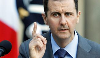 **FILE** Syrian President Bashar Assad (Associated Press)