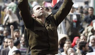 A man identified only as Fathi, wearing the uniform of a captain in the Egyptian army, is carried by demonstrators on Tahrir, or Liberation Square, in Cairo, Egypt, Monday Jan. 31, 2011. A coalition of opposition groups called for a million people to take to Cairo's streets Tuesday to demand the removal of President Hosni Mubarak, the clearest sign yet that a unified leadership was emerging for Egypt's powerful but disparate protest movement. In an apparent attempt to show change, Mubarak named a new government, but the lineup dominated by regime stalwards was greeted with scorn by protesters. (AP Photo/Ben Curtis)