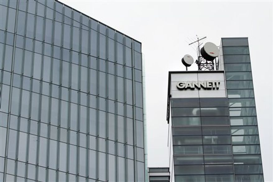 FILE - This file photograph taken July 14, 2010, shows Gannett headquarters in McLean, Va. Gannett Co., the country's biggest newspaper publisher, said Monday, Jan. 31, 2011, fourth-quarter earnings jumped 30 percent as political advertising lifted revenue at its television stations and costs fell. (AP Photo/Jacquelyn Martin, file)