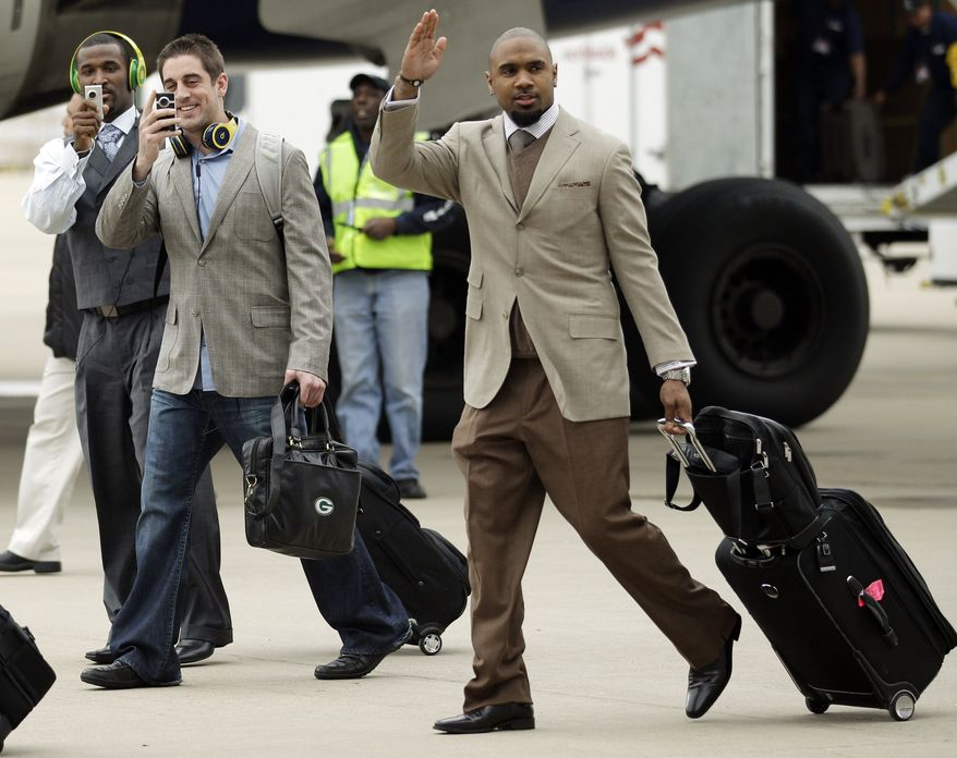 Green Bay Packers' James Jones, left to right, Aaron Rodgers and Charles Woodson arrive at Dallas/Fort Worth International Airport for NFL football Super Bowl XLV Monday, Jan. 31, 2011, in Dallas. (AP Photo/Morry Gash)