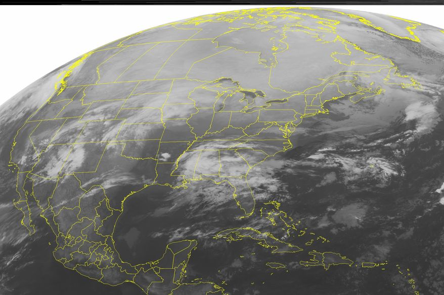 This NOAA satellite image taken on Monday, Jan. 31, 2011, at 12:45 a.m. EST shows cloud cover and precipitation developing in the Northern Plains, ahead of disturbances in the West. (AP Photo/Weather Underground)