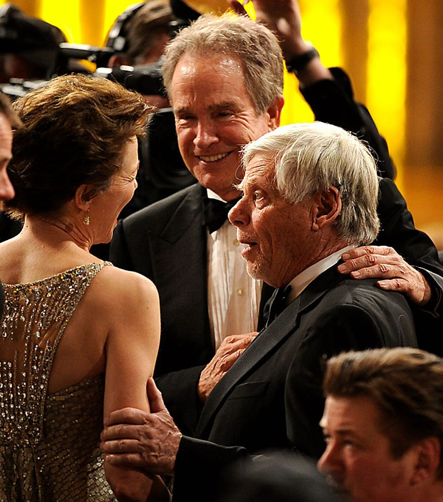 Annette Bening, left, Warren Beatty, center, and Robert Morse at the 17th Annual Screen Actors Guild Awards on Sunday, Jan. 30, 2011, in Los Angeles. (AP Photo/Mark J. Terrill)