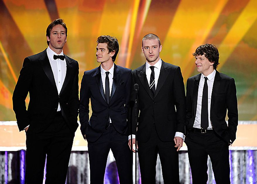 """The cast of """"The Social Network"""" from left, Armie Hammer, Andrew Garfield , Justin Timberlake and Jesse Eisenberg on stage at the 17th Annual Screen Actors Guild Awards on Sunday, Jan. 30, 2011, in Los Angeles. (AP Photo/Mark J. Terrill)"""