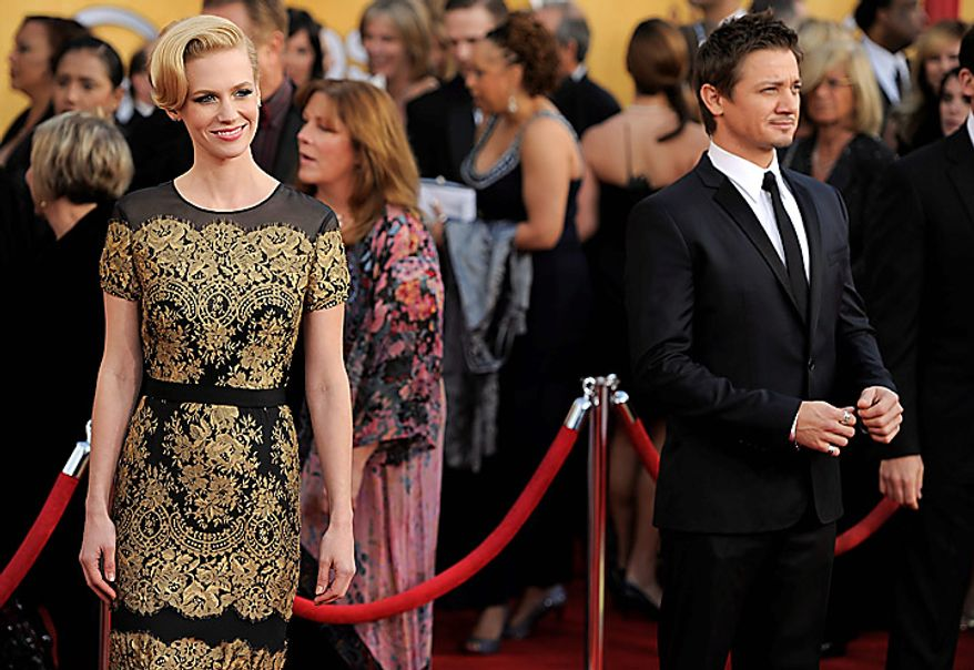 January Jones, left, and Jeremy Renner arrive at the 17th Annual Screen Actors Guild Awards on Sunday, Jan. 30, 2011, in Los Angeles. (AP Photo/Chris Pizzello)