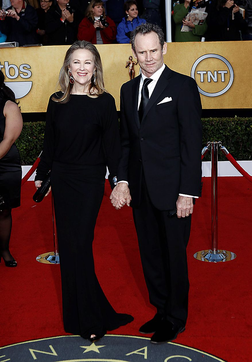 Catherine O'Hara, left, and Bo Welch arrive at the 17th Annual Screen Actors Guild Awards on Sunday, Jan. 30, 2011, in Los Angeles. (AP Photo/Matt Sayles)