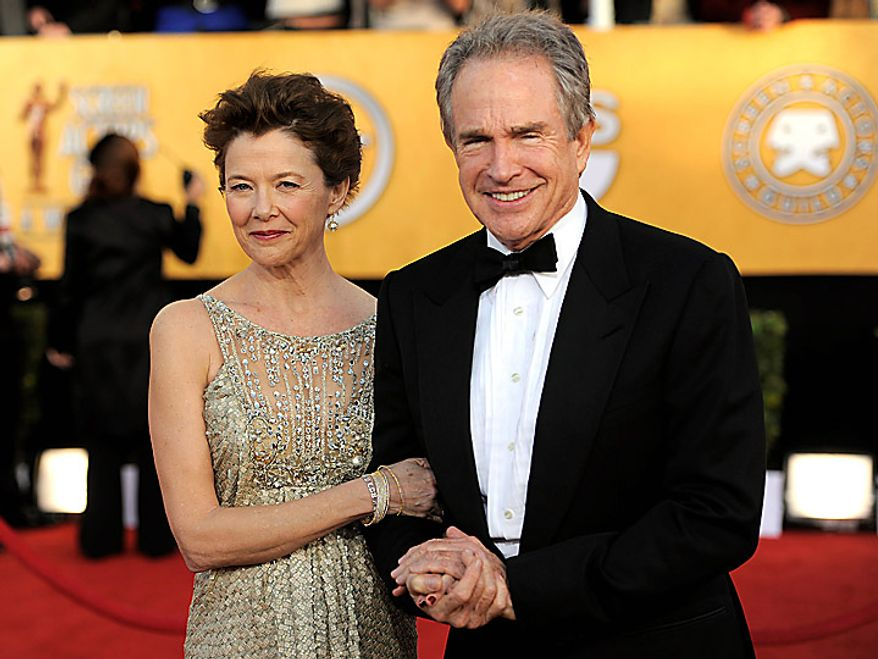 Annette Bening, left, and Warren Beatty arrive at the 17th Annual Screen Actors Guild Awards on Sunday, Jan. 30, 2011, in Los Angeles. (AP Photo/Chris Pizzello)