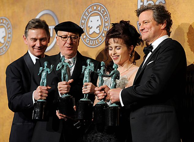 """From left, Anthony Andrews, Geoffrey Rush, Helena Bonham Carter and Colin Firth hold best ensemble awards for """" The King's Speech"""" at the 17th Annual Screen Actors Guild Awards on Sunday, Jan. 30, 2011, in Los Angeles.  Firth also won best actor.  (AP Photo/Chris Pizzello)"""