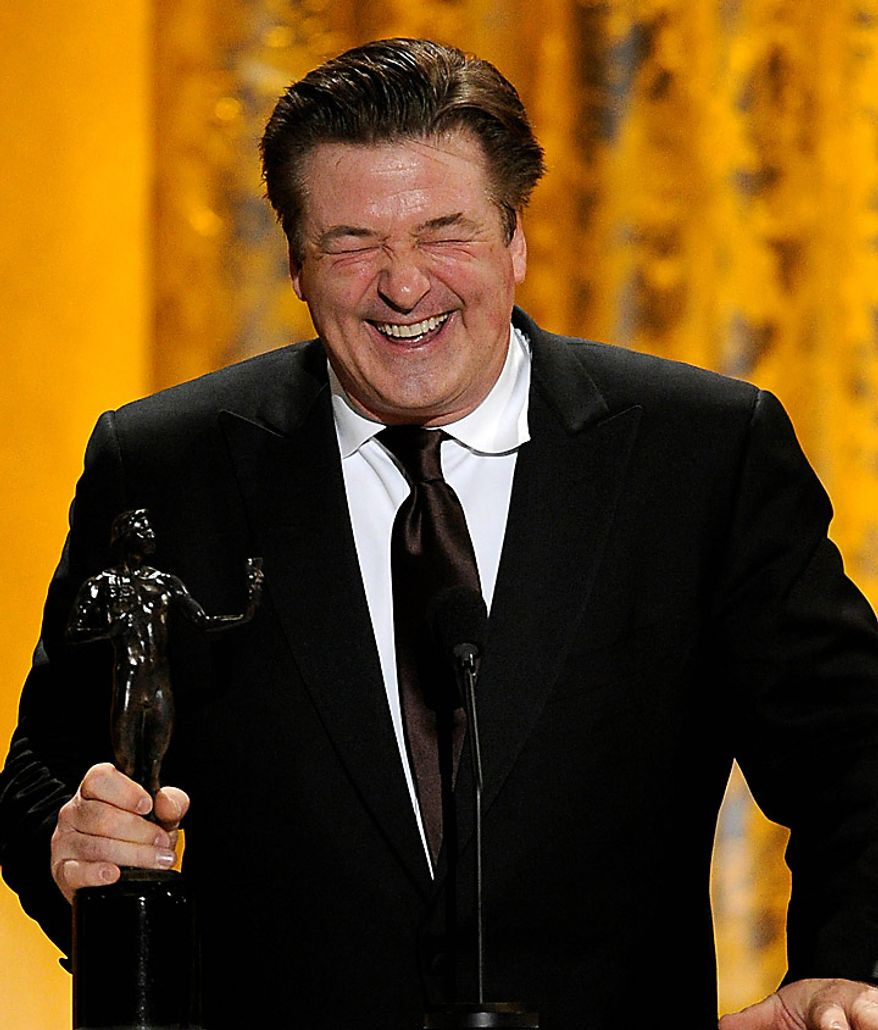 """Alec Baldwin accepts the award for best male actor in a comedy series for """"30 Rock"""" at the 17th Annual Screen Actors Guild Awards on Sunday, Jan. 30, 2011, in Los Angeles. (AP Photo/Mark J. Terrill)"""