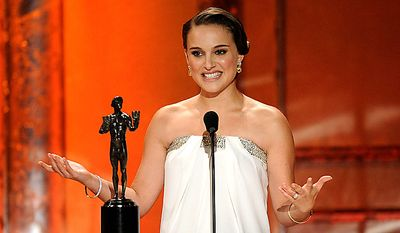 "Natalie Portman accepts the award for best female actor in a leading role for ""Black Swan"" at the 17th Annual Screen Actors Guild Awards on Sunday, Jan. 30, 2011, in Los Angeles. (AP Photo/Mark J. Terrill)"