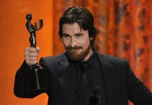 """Christian Bale accepts the award for best male actor in a supporting role for """"The Fighter"""" at the 17th Annual Screen Actors Guild Awards on Sunday in Los Angeles. (Associated Press)"""