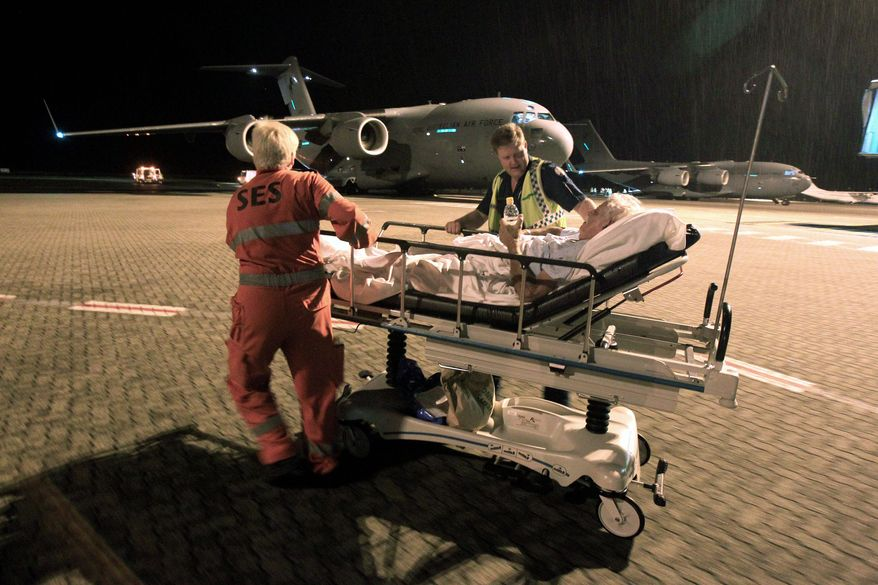 Hospital patients are transported to safety as Cyclone Yasi threatens massive damage in Cairns, Australia. Extra commercial flights were scheduled so residents could evacuate. (Associated Press)