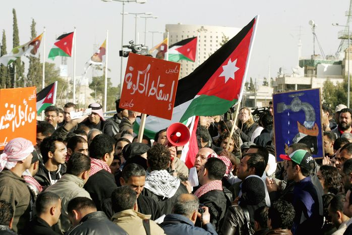 Jordanian protesters shout anti-government slogans during a demonstration at the prime minister's office in Amman, Jordan, on Saturday. The opposition supporters demand that the prime ministe