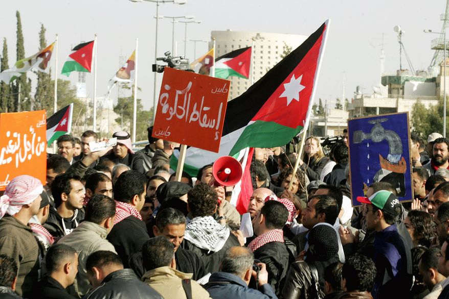 Jordanian protesters shout anti-government slogans during a demonstration at the prime minister's office in Amman, Jordan, on Saturday. The opposition supporters demand that the prime minister step down as they vent their anger at rising prices, inflation and unemployment in Jordan. (Associated Press)