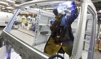 A worker welds a truck cab frame on the Volvo truck assembly line at the Volvo plant in Dublin, Va, on Jan. 26, 2011. The factory sector expanded in January at the fastest pace in seven years, as manufacturers reported a sharp jump in new orders. (AP Photo/Steve Helber)