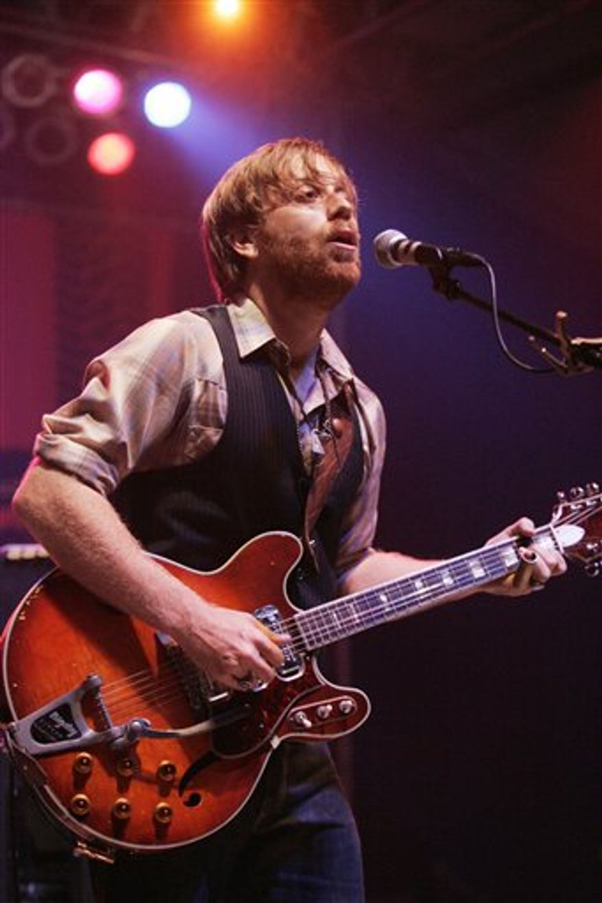 FILE - In this June 11, 2010 file photo, Dan Auerbach of the band The Black Keys perform at the Bonnaroo Music and Arts Festival in Manchester, Tenn. (AP Photo/Jeff Christensen, File)