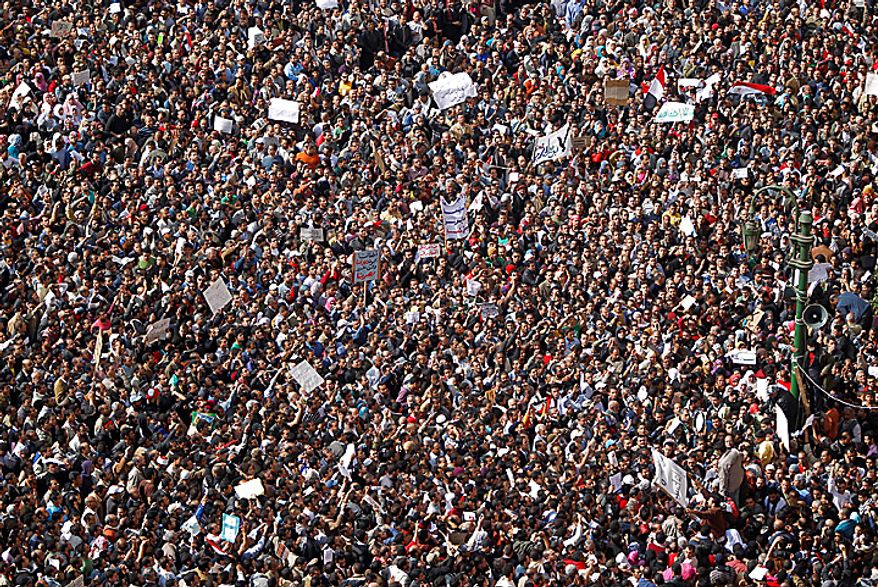 The crowd gathers in Tahrir, or Liberation, Square in Cairo on Tuesday, Feb. 1, 2011. More than a quarter-million people flooded into the heart of Cairo, filling the city's main square in by far the largest demonstration in a week of unceasing demands for President Hosni Mubarak to leave after nearly 30 years in power. (AP Photo/Tara Todras-Whitehill)