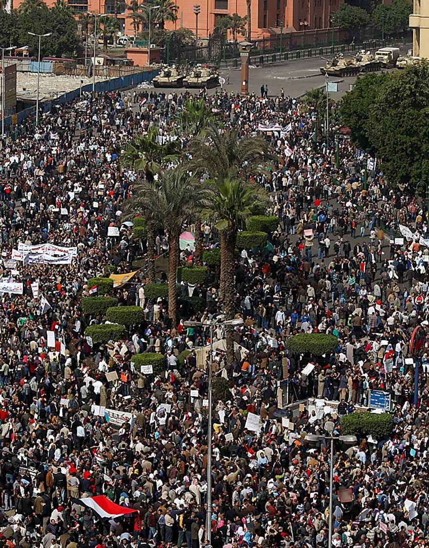 The crowd gathers in Tahrir, or Liberation, Square in Cairo on Tuesday, Feb. 1, 2011. More than a quarter-million people flooded into the heart of Cairo, filling the city's main square in by far the largest demonstration in a week of unceasing demands for President Hosni Mubarak to leave after nearly 30 years in power. (AP Photo/Khalil Hamra)