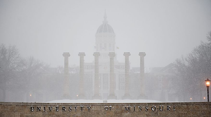 Snow falls on the empty University of Missouri quadrangle on Tuesday, Feb. 1, 2011, in Columbia, Mo. The university closed on Tuesday because of an approaching blizzard. (AP Photo/L.G. Patterson)