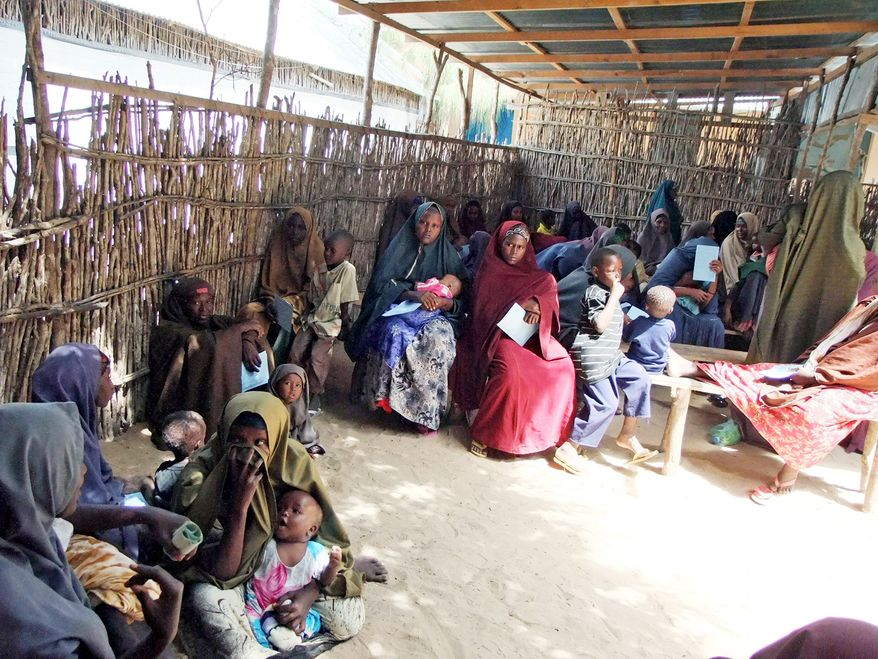 Patients await treatment at the Hawa Abdi hospital, which cared for more than 162,000 people last year. It now must perform brutal triage to determine who is most in need. (Associated Press)