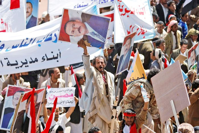 Supporters of Yemeni President Ali Abdullah Saleh, in power since 1978, rally in Sanaa on Wednesday. He told parliament Wednesday that he will not seek another term or turn over power to his son. (Associated Press)