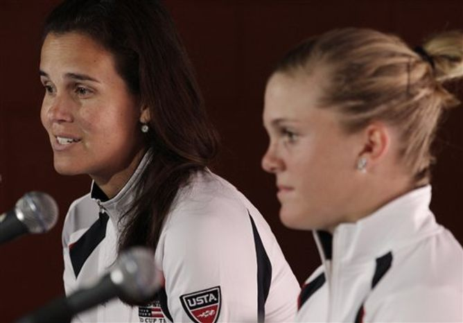Belgium's Kim Clijsters, right, and Kirsten Flipkens, address the media ahead of the Fed Cup World Group first round match Belgium - USA, in Antwerp, Belgium, Wednesday, Feb. 2, 2011. (AP Photo/Yves Logghe)