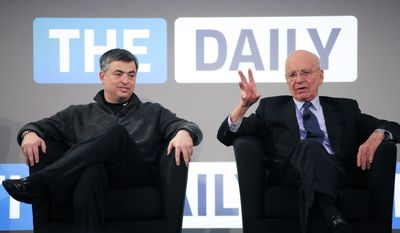Rupert Murdoch, right, Chairman and CEO of News Corp., and Eddy Cue, vice president of Apple, attend the launch of the Daily, Wednesday, Feb. 2, 2011 in New York. The Daily is the world's first iPad-only newspaper. (AP Photo/Mark Lennihan)