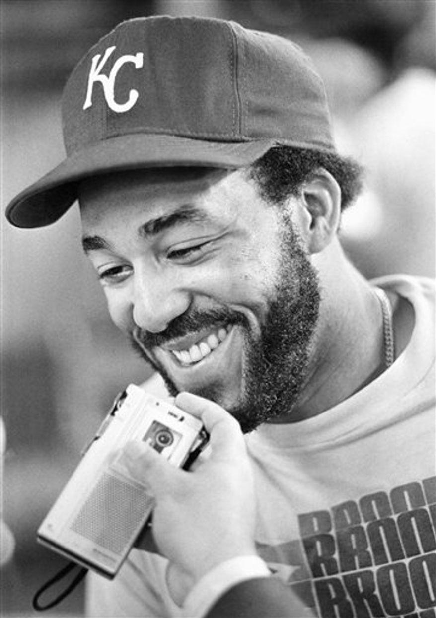 FILE - In this Oct. 9, 1980 file photo, Kansas City Royals baseball Willie Mays Aikens  is all smiles as he recorded tape for Latin American radio in the clubhouse at Royals Stadium in Kansas City.  Aikens, who went from World Series star to federal prison inmate, has been hired by the Kansas City Royals as a minor league coach on Tuesday, Feb. 1, 2010. (AP Photo/John Filo, File)