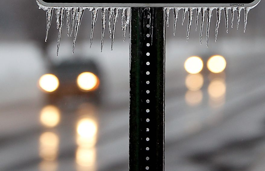 Icicles hang from a sign Wednesday, Feb. 2, 2011 in Hightstown, N.J. Freezing rain overnight left a coating of ice on New Jersey roads, encased trees and power lines, and glazed snow drifts. (AP Photo/Mel Evans)