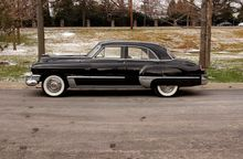 The profile of the two-ton Cadillac on its 126-wheelbase reveals why the car delivers a cushy ride.
