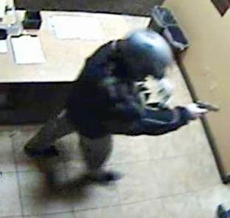 Surveillance video shows a man wearing a motorcycle helmet robbing the Suncoast casino in Las Vegas on Dec. 8. Police think he is the same one who hit the Bellagio on Dec. 14. (Associated Press)