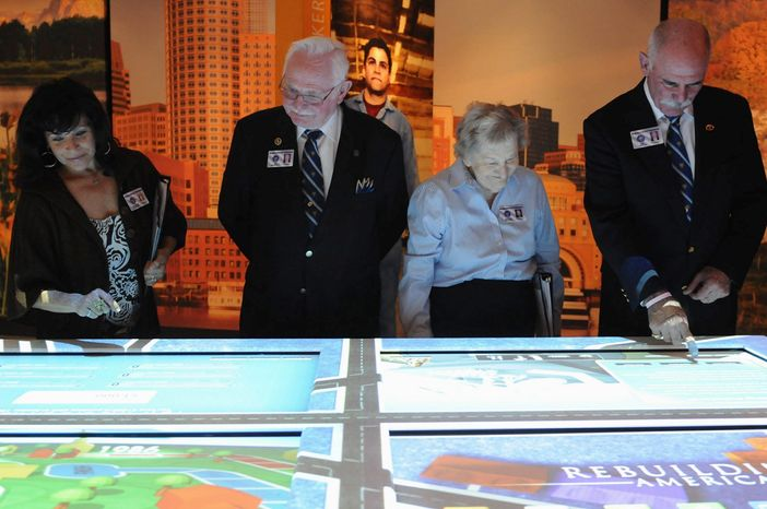 Docents at the Ronald Reagan Library and Museum in Simi Valley, Calif., try out a new multimedia exhibit, part of a $15 million renovation and enlargement. (Garrett Cheen/Special to The Washington Times)