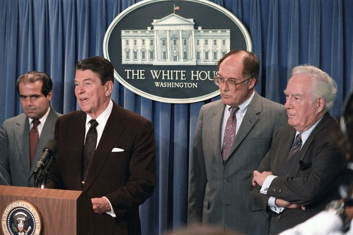 President Reagan announces the resignation of Chief Justice Warren E. Burger (right) during a briefing at the White House on June 17, 1986. Reagan said he would nominate Justice William H. Rehnquist (second from right) to the post of chief justice and Antonin Scalia (left) as a member of the Supreme Court. (Associated Press)