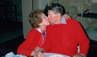 Former President Ronald Reagan celebrates with his wife, Nancy, at their Bel-Air home in Los Angeles on Feb. 6, 2000, Reagan's 89th birthday. Reagan died four years later of pneumonia, a common Alzheimer's disease complication. (Associated Press)