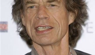"FILE - In this May 19, 2010 file photo, musician Mick Jagger poses during a photo call for the film ""Stones in Exile"", at the 63rd international film festival, in Cannes, southern France. (AP Photo/Joel Ryan, file)"