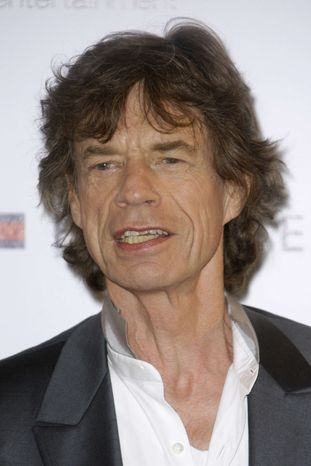 """** FILE ** In this May 19, 2010, file photo, musician Mick Jagger poses during a photo call for the film """"Stones in Exile,"""" at the 63rd international film festival, in Cannes, southern France. (AP Photo/Joel Ryan, file)"""
