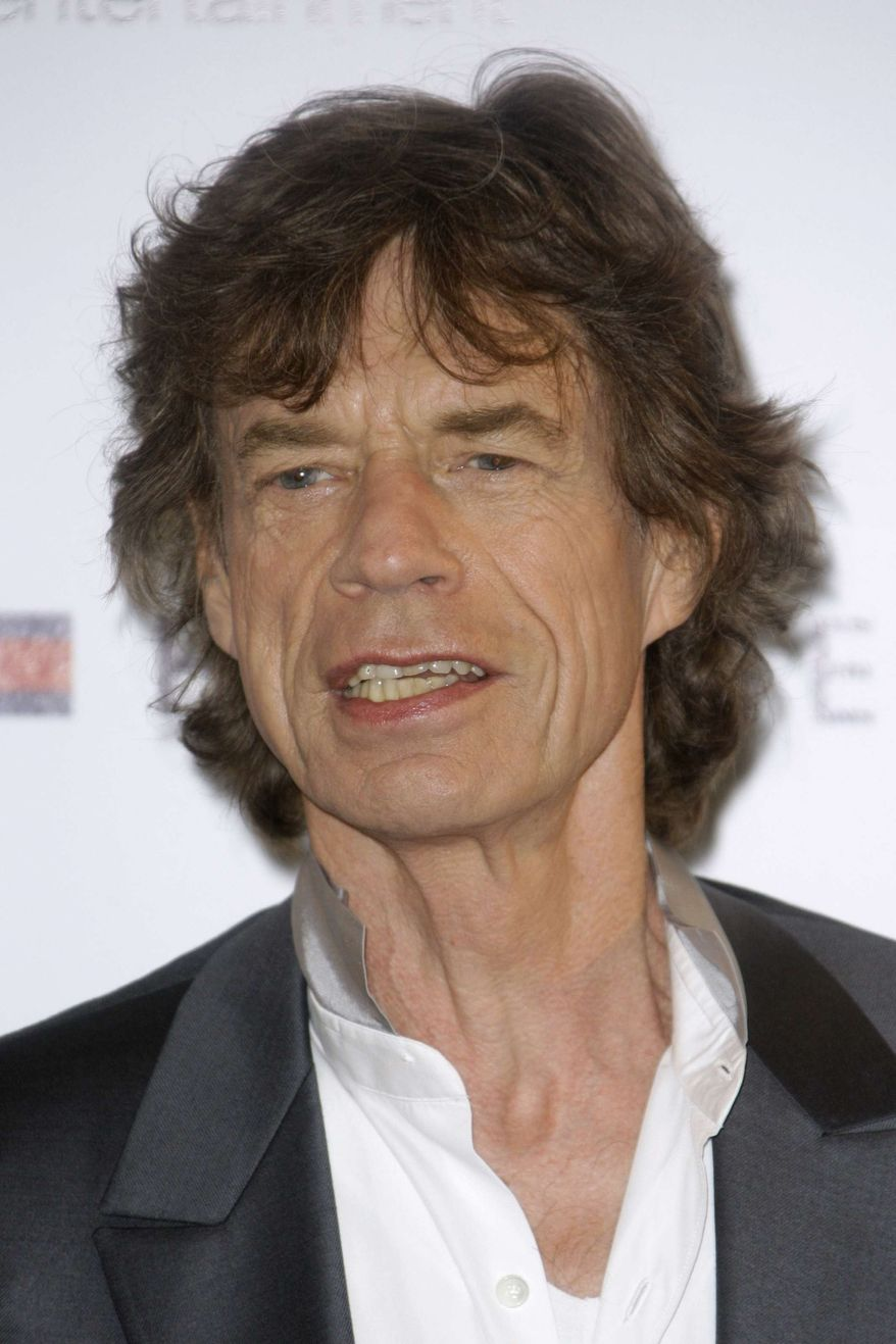 "** FILE ** In this May 19, 2010, file photo, musician Mick Jagger poses during a photo call for the film ""Stones in Exile,"" at the 63rd international film festival, in Cannes, southern France. (AP Photo/Joel Ryan, file)"