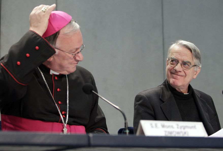 Archbishop Zygmunt Zimowski, secretary of the Pontifical Council for Pastoral Assistance to Health Care Workers, left, and Vatican spokesman Federico Lombardi attend a press conference at the Vatican on Thursday, Feb. 3, 2011. The Vatican health office announced it will host an international conference in May on preventing AIDS and caring for those afflicted with it amid continued confusion over its position concerning condoms as a way to prevent HIV transmission. (AP Photo/Pier Paolo Cito)