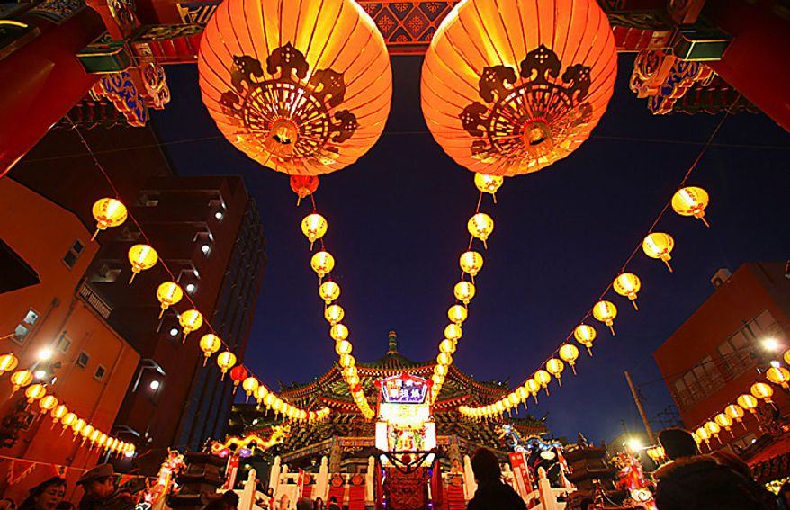 Japanese worshippers pray at Mazu temple during the Lunar New Year celebration in Yokohama, near Tokyo, Thursday, Feb. 3, 2011. (AP Photo/Junji Kurokawa)