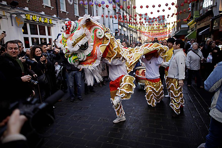 Performers mark the Chinese New Year with a traditional Chinese Lion Dance in the China Town district of London, Thursday, Feb. 3, 2011.  Thursday heralds the start of the Chinese Year of the Rabbit.  (AP Photo/Matt Dunham)