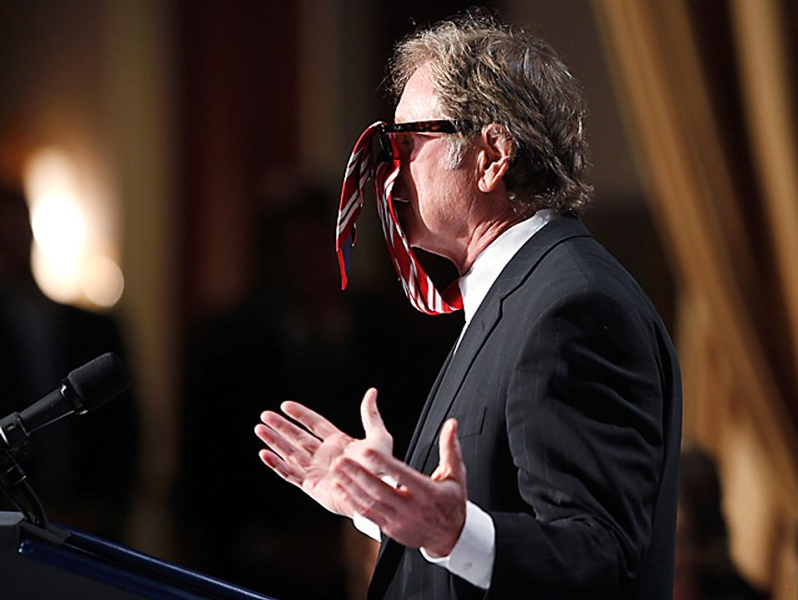 Screenwriter and director Randall Wallace shows his necktie caught in his sunglasses as he tells a story at the National Prayer Breakfast, which President Obama attended, in Washington on Thursday, Feb. 3, 2011. (AP Photo/Charles Dharapak)
