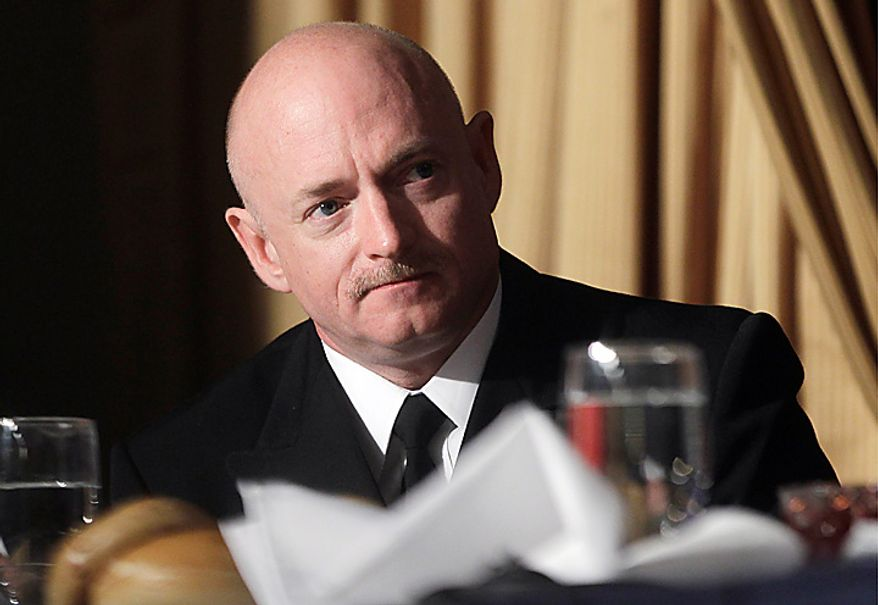 Astronaut Mark Kelly, husband of wounded Rep. Gabrielle Giffords, Arizona Democrat, is acknowledged by President Obama at the National Prayer Breakfast in Washington on Thursday, Feb. 3, 2011. (AP Photo/Charles Dharapak)