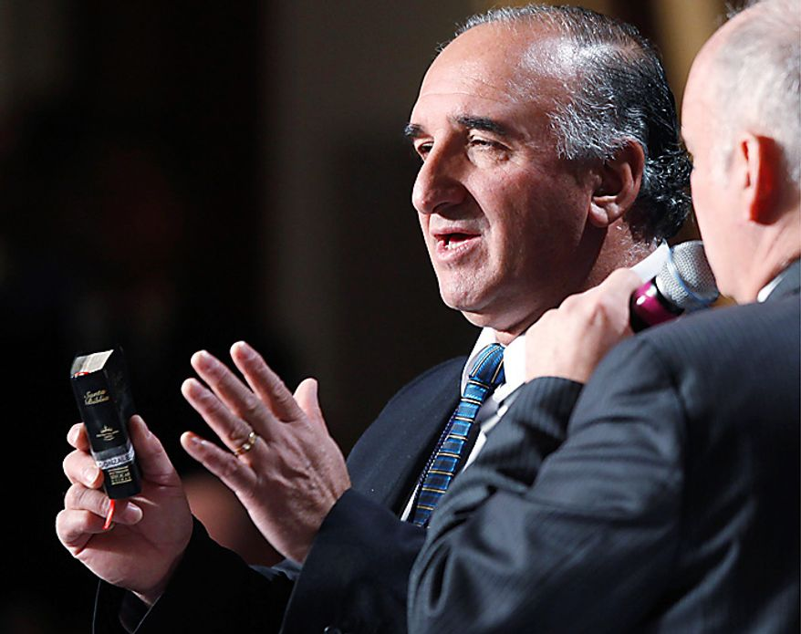 Chilean miner Jose Enriquez holds a Bible as he speaks at the National Prayer Breakfast, which President Obama attended, in Washington on Thursday, Feb. 3, 2011. (AP Photo/Charles Dharapak)